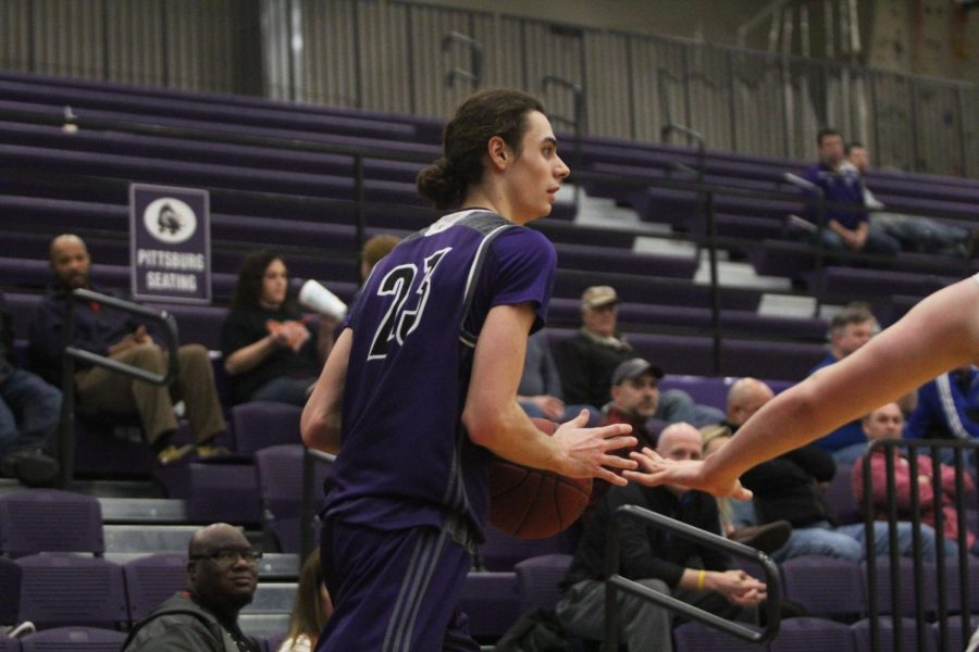 Blue Valley Northwest senior forward Parker Braun (23) dribbles the ball on the perimeter during the fourth quarter of the Huskies matchup with Olathe Northwest at Pittsburg High Jan. 19. The Huskies defeated the Ravens, 52-38.