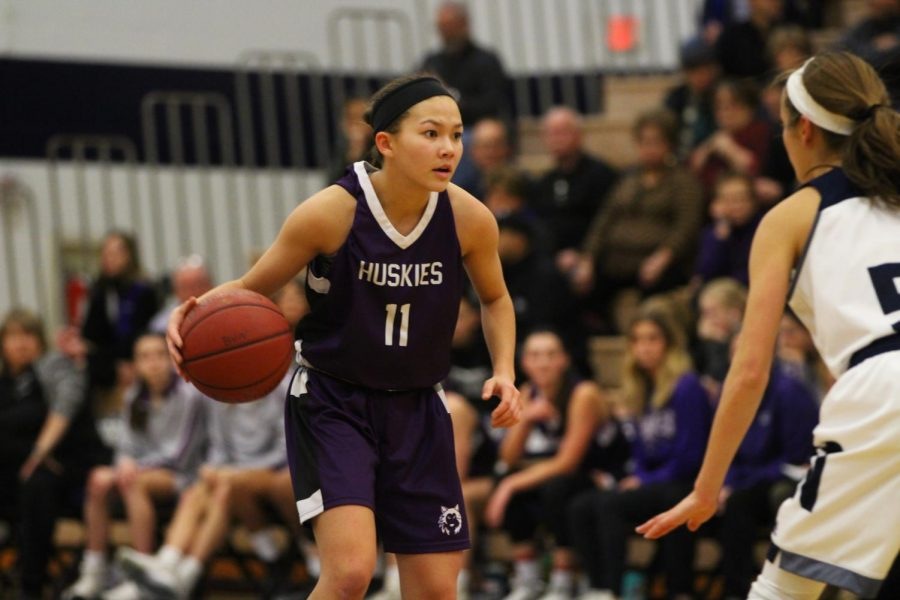 Blue Valley Northwest junior guard Haley Shin (11) dribbles the ball during the first half of the Huskies matchup with Blue Valley North at BVN Jan. 12.