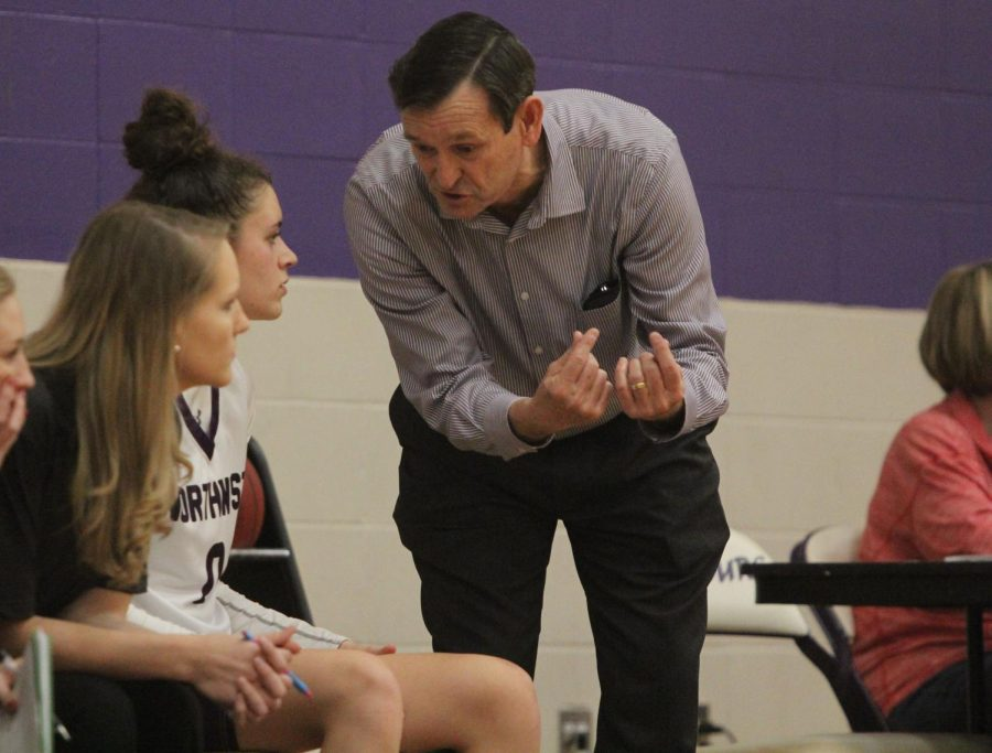Head coach Brian Bubalo coaches up senior guard Becky Delgado (0) during the second half of the Huskies matchup with Pittsburg High at PHS Jan. 20. The Huskies defeated the Purple Dragons, 54-29.