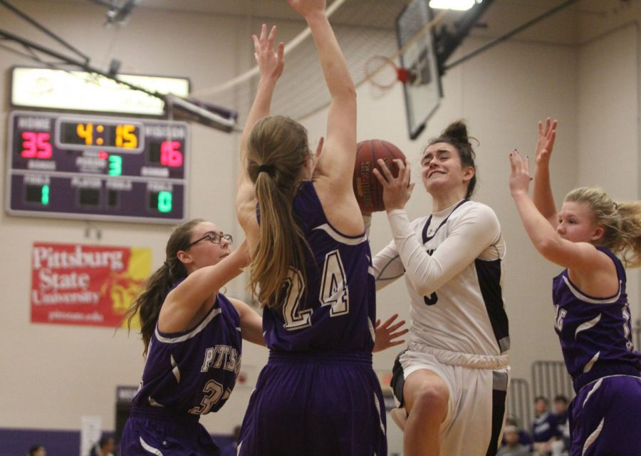 Blue Valley Northwest senior guard Becky Delgado (0) goes up for a layup during the second half of the Huskies matchup with Pittsburg High at PHS Jan. 20. The Huskies defeated the Purple Dragons, 54-29.