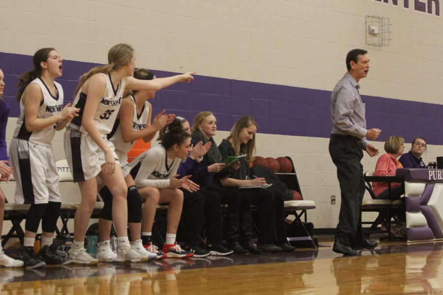 Blue Valley Northwest head coach Brian Bubalo and the Huskies bench gets excited after a play during the Huskies matchup with Pittsburg High at PHS Jan. 20. The Huskies defeated the Purple Dragons, 54-29.