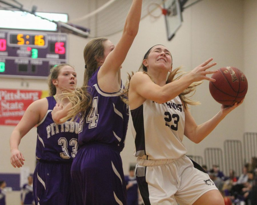 Blue Valley Northwest senior guard Kate Kaufman (23) goes up for a layup during the second half of the Huskies matchup with Pittsburg High at PHS Jan. 20. The Huskies defeated the Purple Dragons, 54-29.