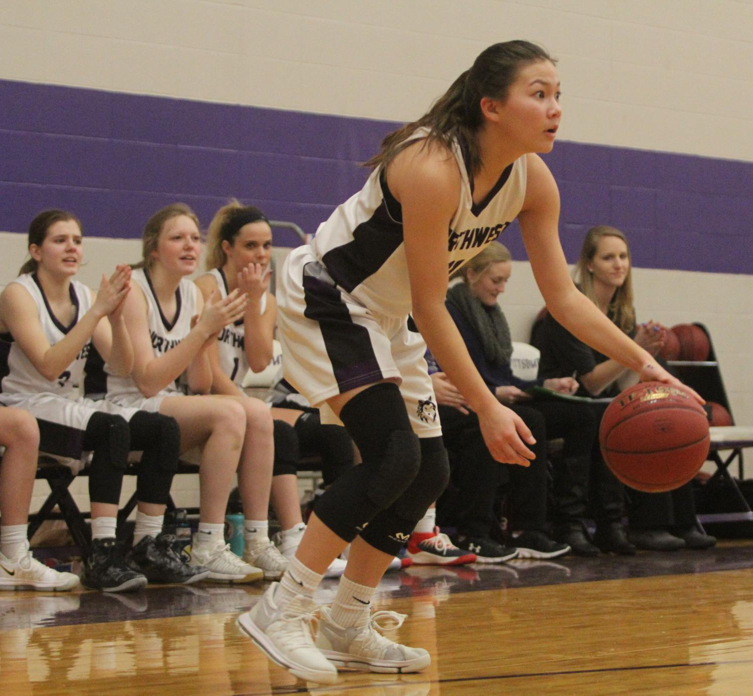 Blue Valley Northwest senior guard Haley Shin (11) dribbles the ball during the fourth quarter of last year's matchup with Pittsburg High at PHS Jan. 20. The Huskies defeated the Purple Dragons, 54-29.