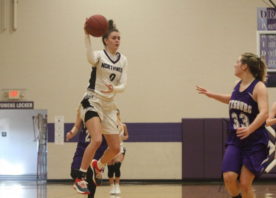 Blue Valley Northwest senior guard Becky Delgado (0) jumps to pass the ball during the fourth quarter of the Huskies matchup with Pittsburg High at PHS Jan. 20. The Huskies defeated the Purple Dragons, 54-29.