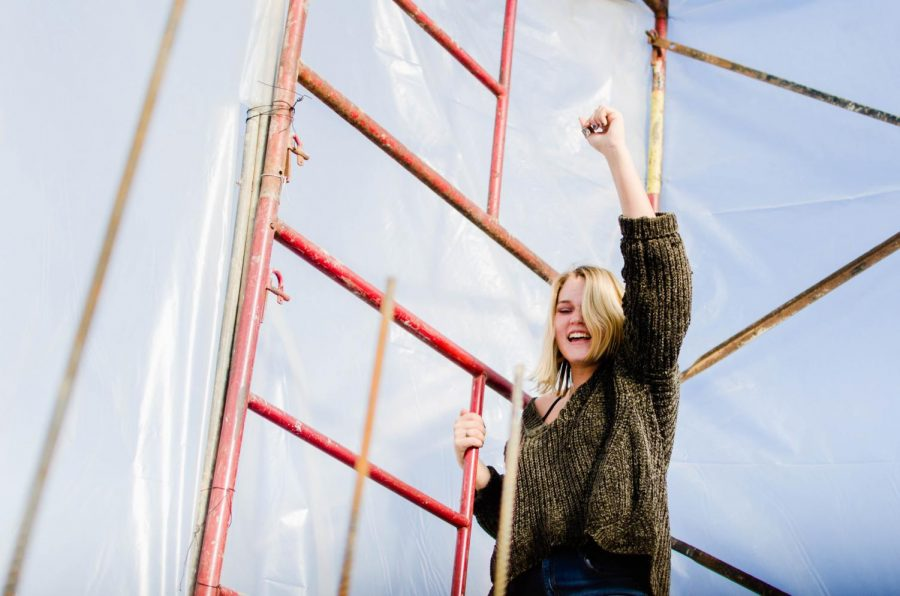 Christie celebrates her climb to the top of the ladder at the first location.