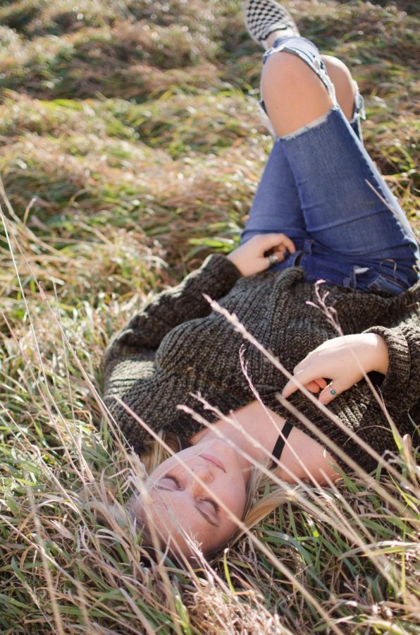 Christie lays in the withering grass at the second location.