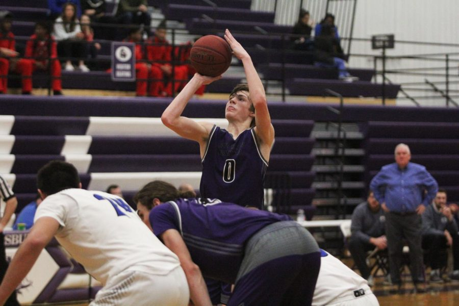 Blue Valley Northwest junior guard Christian Braun (0) shoots a free throw during the first quarter of the Huskies matchup with Olathe Northwest at Pittsburg High Jan. 19. The Huskies defeated the Ravens, 52-38.