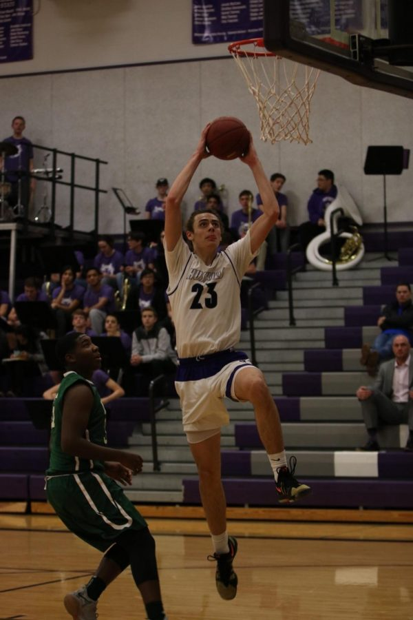 Blue Valley Northwest senior forward Parker Braun (23) goes up for a dunk attempt during the first quarter of the Huskies matchup with East at BVNW Jan. 30. The Huskies defeated the Bears, 87-28.
