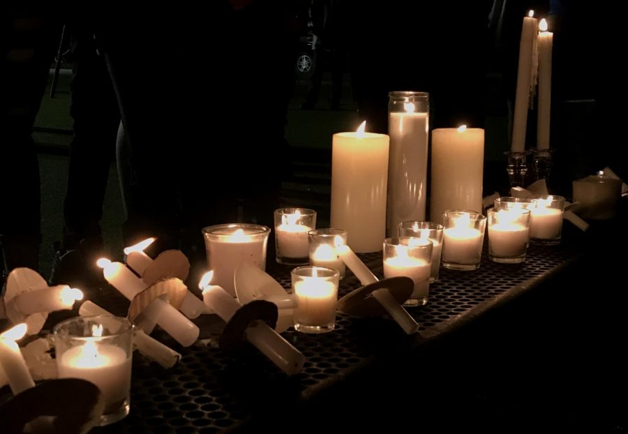Candles line up a bench at Sunset Ridge Elementary.