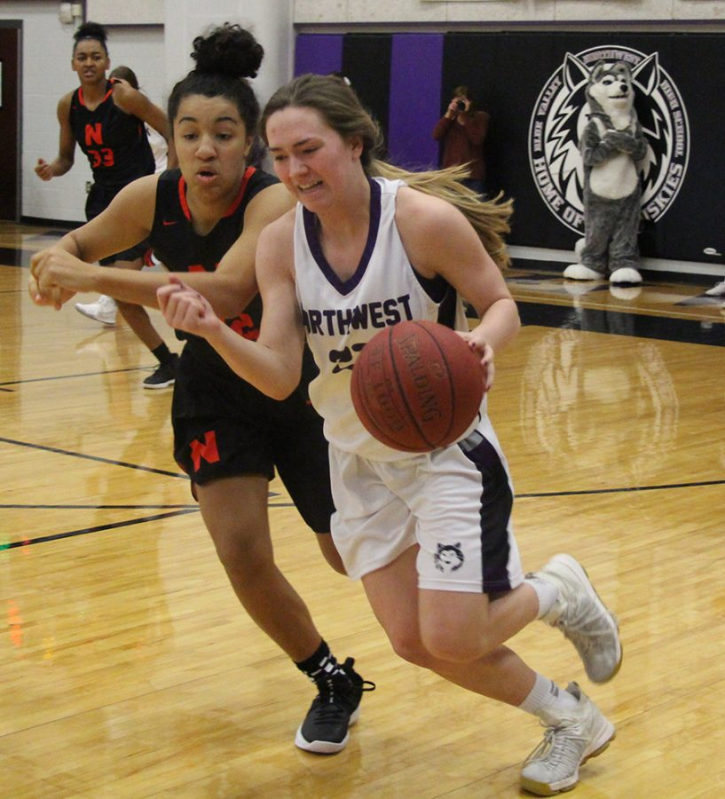 BVNW senior Kate Kaufman (23) gets pushed out of bounds by a Shawnee Mission North player Jan. 3 at BVNW.