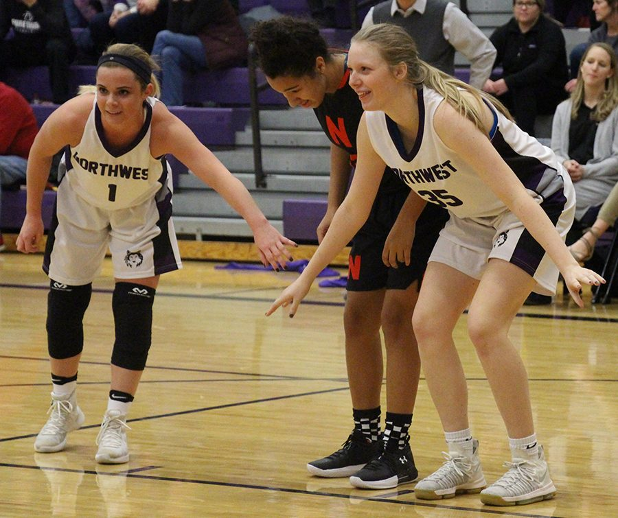 Junior Cate McClain (1) and junior Madison Gerard (35) box out during a free throw in their game against Shawnee Mission North Jan. 3.