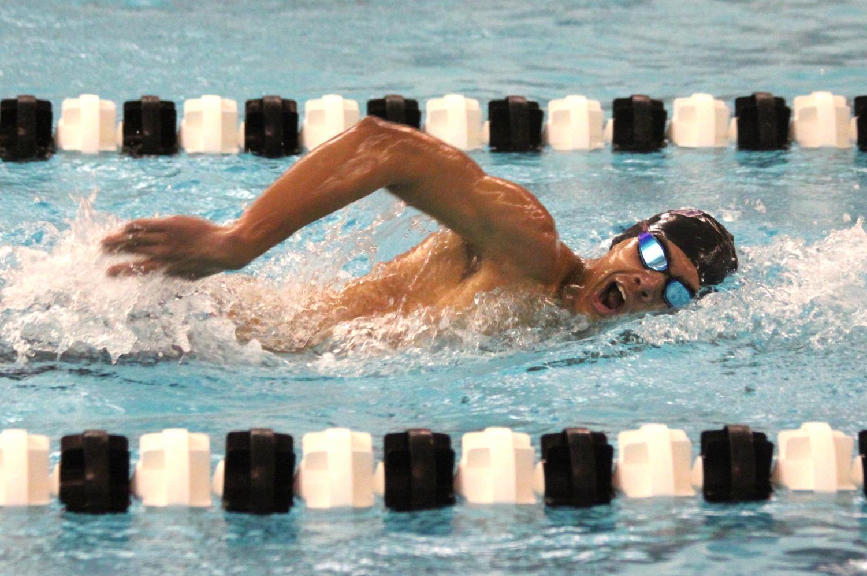 Senior JP Larson swims in a meet during the 2017-18 season.