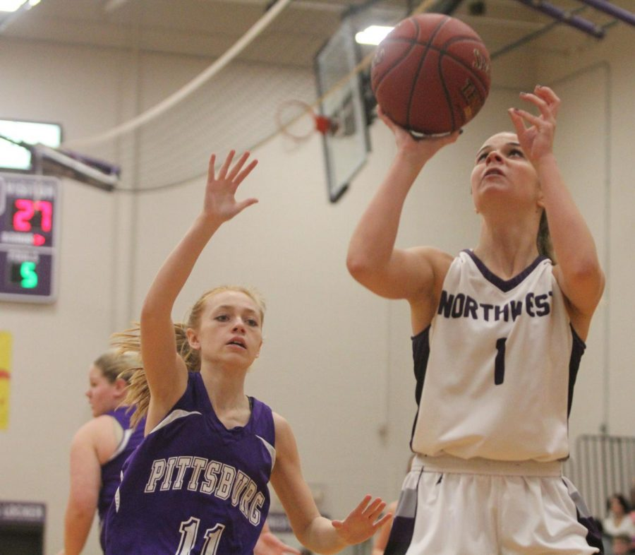 Blue Valley Northwest junior guard Cate McClain (1) goes up for a layup during the second half of the Huskies matchup with Pittsburg High at PHS Jan. 20. The Huskies defeated the Purple Dragons, 54-29.