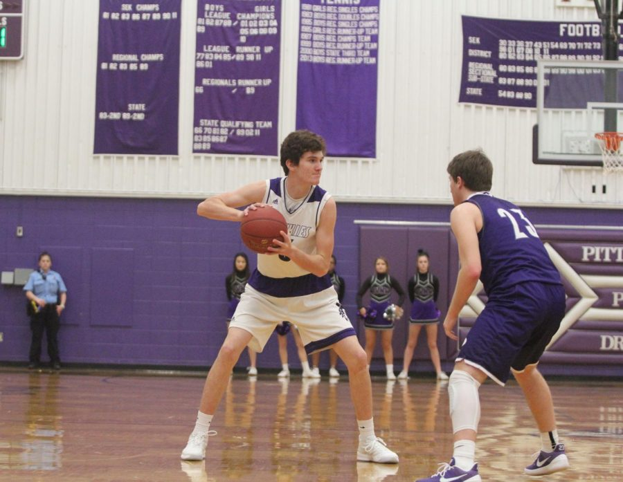 Blue Valley Northwest freshman guard Jack Chapman (3) goes to pass the ball during the first half of the Huskies matchup with Pittsburg High at PHS Jan. 20. The Huskies defeated the Purple Dragons, 68-41.