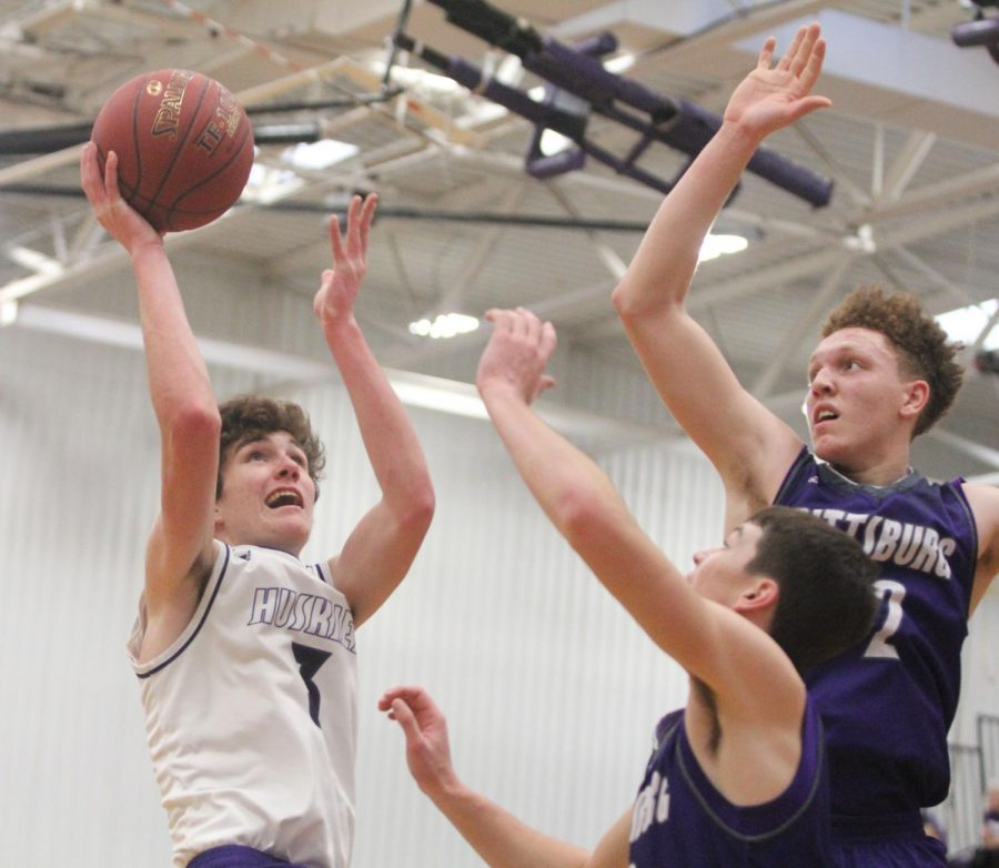 Blue Valley Northwest freshman guard Jack Chapman (3) goes up for a layup during the first half of the Huskies matchup with Pittsburg High at PHS Jan. 20. The Huskies defeated the Purple Dragons, 68-41.
