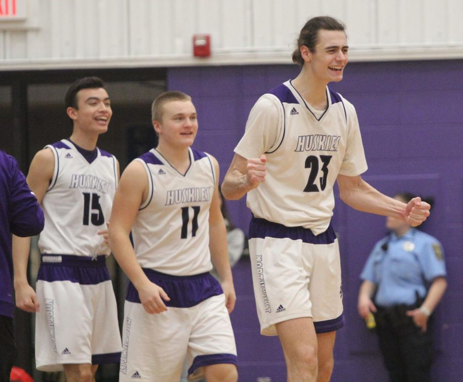 Blue Valley Northwest players Nathan Burger (15), Jack Hungerford (11) and Parker Braun (23) get excited after Pittsburg calls a timeout during the Huskies matchup with Pittsburg High at PHS Jan. 20. The Huskies defeated the Purple Dragons, 68-41.