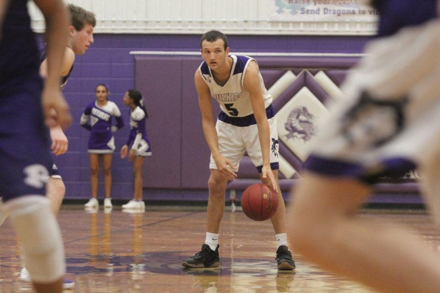 Blue Valley Northwest senior guard Sam Ward (5) dribbles the ball as the Huskies run their offense during the second half of of the Huskies matchup with Pittsburg High at PHS Jan. 20. The Huskies defeated the Purple Dragons, 68-41.