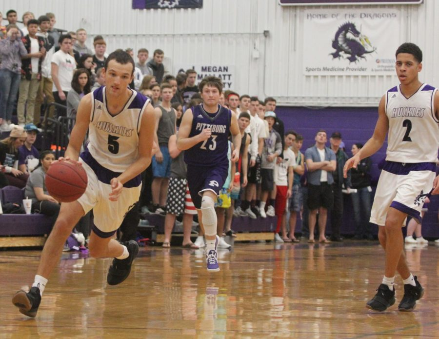Blue Valley Northwest senior guard Sam Ward (5) prepares for a dunk attempt during the second half of of the Huskies matchup with Pittsburg High at PHS Jan. 20. The Huskies defeated the Purple Dragons, 68-41.