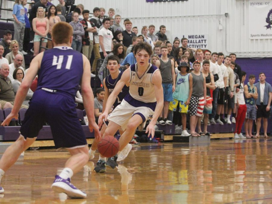 Blue Valley Northwest junior guard Christian Braun (0) dribbles the ball around PHS defenders during the Huskies matchup with Pittsburg High at PHS Jan. 20. The Huskies defeated the Purple Dragons, 68-41.