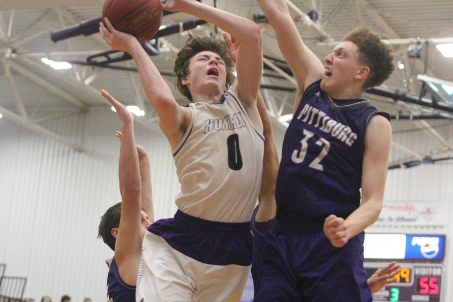 Blue Valley Northwest junior guard Christian Braun (0) goes up for a contested layup during the second half of the Huskies matchup with Pittsburg High at PHS Jan. 20. The Huskies defeated the Purple Dragons, 68-41.