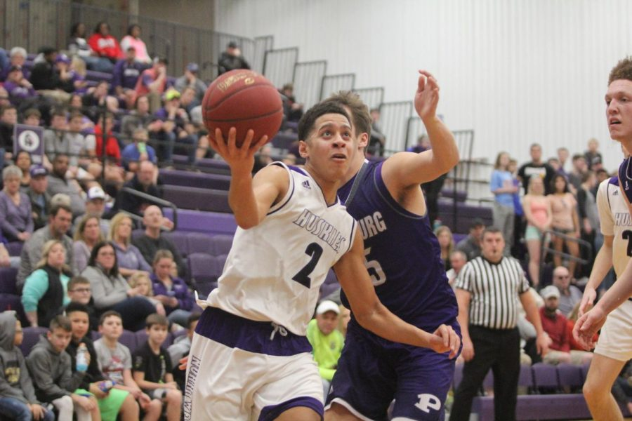 Blue Valley Northwest senior guard Max Johnson goes up for a layup during the second half of the Huskies matchup with Pittsburg High. The Huskies defeated the Purple Dragons, 68-41.