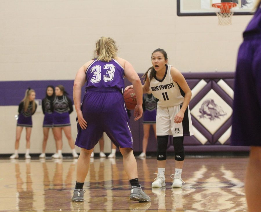 Blue Valley Northwest junior guard Haley Shin (11) dribbles the ball at the top of the key during the first  half of the Huskies matchup with Pittsburg High at PHS Jan. 20. The Huskies defeated the Purple Dragons, 54-29.