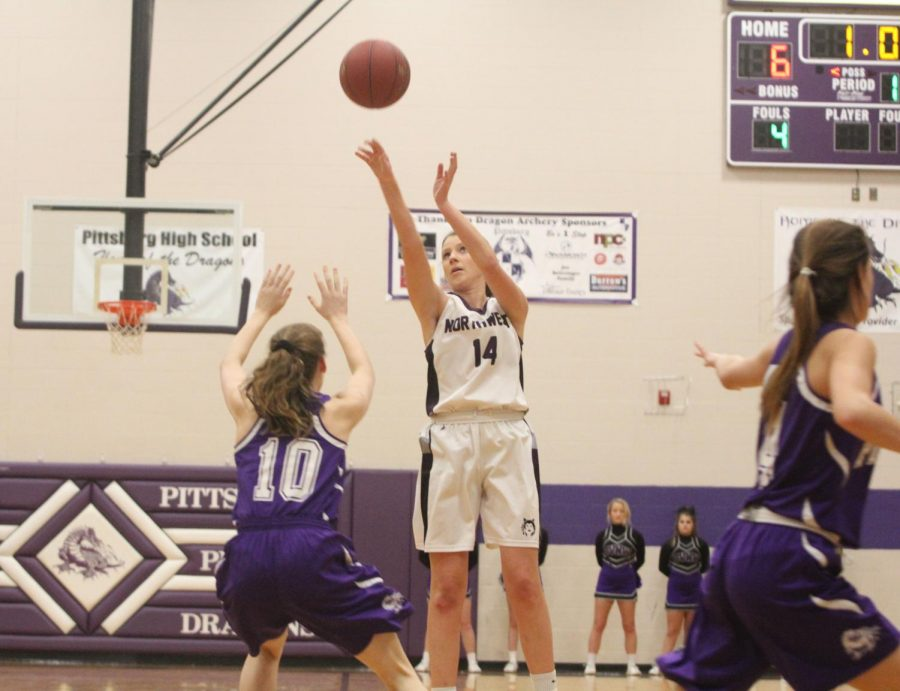 Blue Valley Northwest senior forward Sarah Martin (14) shoots the ball during the first half of the Huskies matchup with Pittsburg High at PHS Jan. 20. The Huskies defeated the Purple Dragons, 54-29.