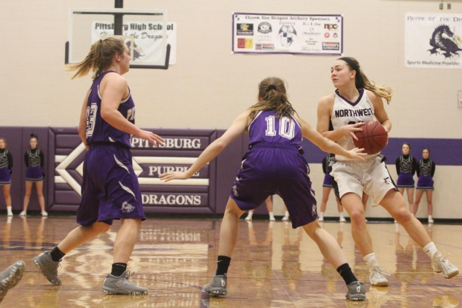 Blue Valley Northwest senior guard Kate Kaufman (23) looks for a pass during the first quarter of the Huskies matchup with Pittsburg High at PHS Jan. 20. The Huskies defeated the Purple Dragons, 54-29.