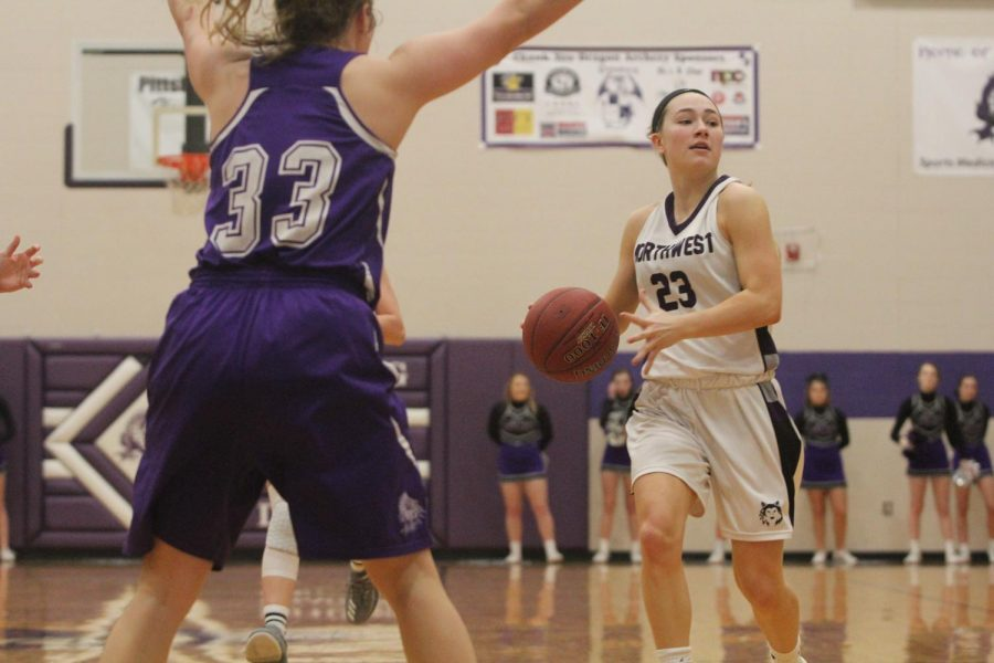 Blue Valley Northwest senior guard Kate Kaufman looks for a pass during the first half of the Huskies matchup with Pittsburg High at PHS Jan. 20. The Huskies defeated the Purple Dragons, 54-29.