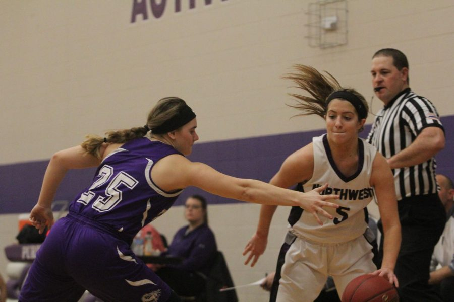 Blue Valley Northwest senior guard Bridget Harrison (5) drives the ball past a Pittsburg defender during the first half of the Huskies matchup with Pittsburg High at PHS Jan. 20. The Huskies defeated the Purple Dragons, 54-29.