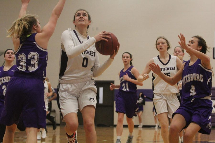 Blue Valley Northwest senior guard Becky Delgado (0) goes up for a layup during the first half of the Huskies matchup with Pittsburg High at PHS Jan. 20. The Huskies defeated the Purple Dragons, 54-29.