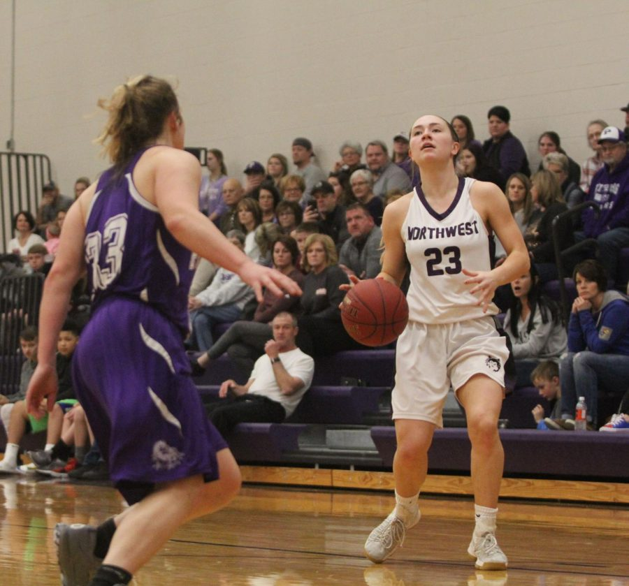 Blue Valley Northwest senior guard Kate Kaufman (23) prepares to shoot the ball during the fourth quarter of the Huskies matchup with Pittsburg High at PHS Jan. 20. The Huskies defeated the Purple Dragons, 54-29.