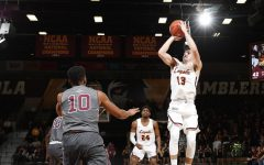 2014 graduates win conference awards at Loyola Chicago