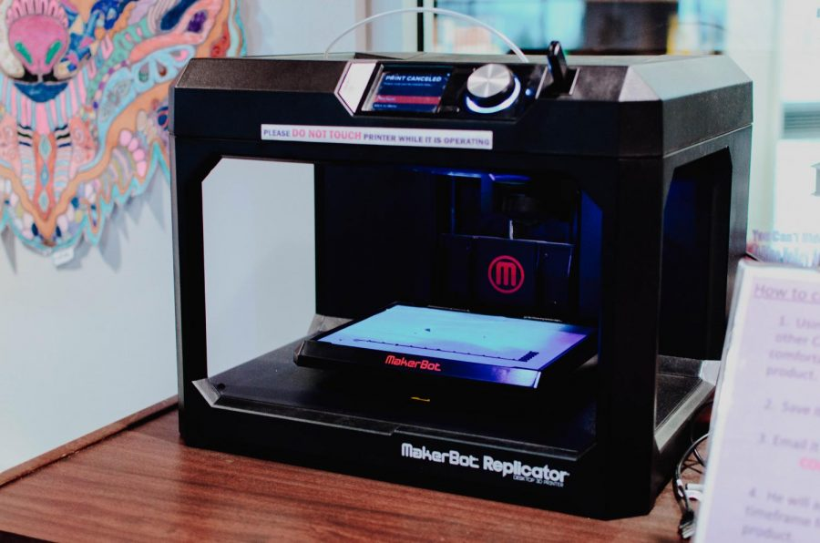 The MakerBot printer sits near the front of the Library Media Center.