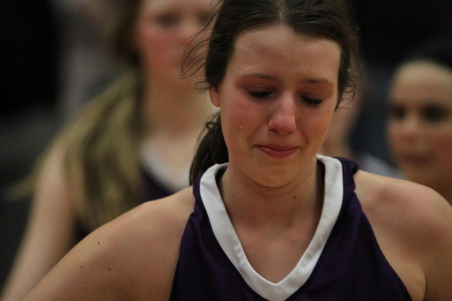 Blue Valley Northwest senior forward Sarah Martin cries after the Huskies substate matchup with Shawnee Mission Northwest at SMNW Feb. 27. The Huskies were defeated by the Cougars, 43-34.