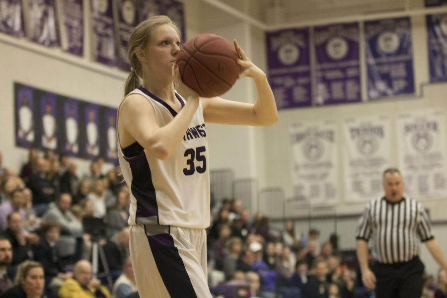 Blue Valley Northwest junior forward Madison Gerard (35) shoots the ball during the first quarter of the Huskies matchup with St. James Academy at BVNW Feb. 23. The Huskies were defeated by the Thunder, 37-33.