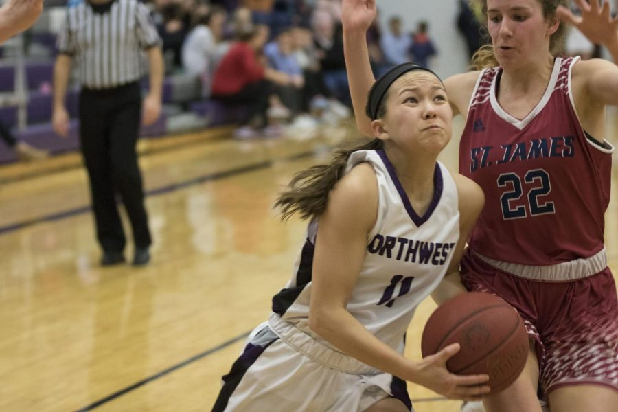 Blue Valley Northwest junior guard Haley Shin (11) goes up for a layup during the second half of the Huskies matchup with St. James Academy at BVNW Feb. 23. The Huskies were defeated by the Thunder, 37-33.