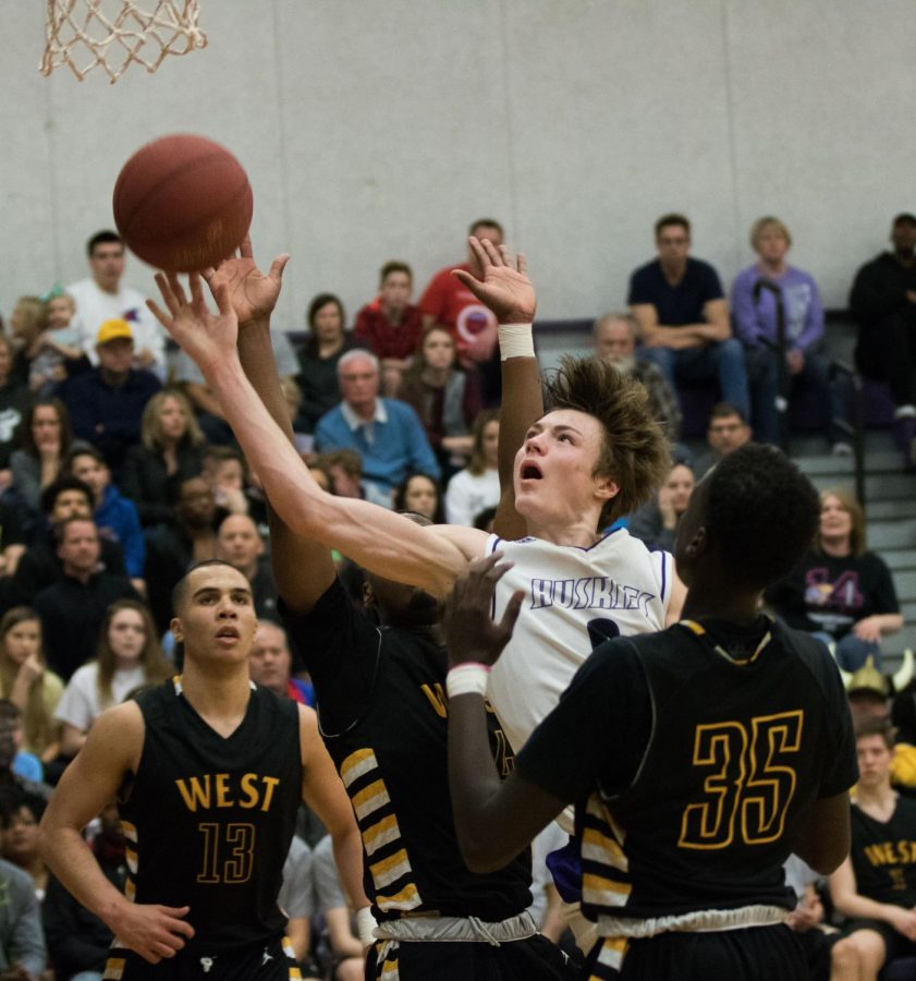 Blue+Valley+Northwest+junior+guard+shoots+the+ball+during+the+first+half+of+the+Huskies+matchup+with+Shawnee+Mission+West+at+BVNW+March+3.+The+Huskies+defeated+the+Vikings%2C+67-36.
