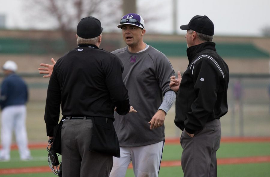 Head coach Corby Lange argues a call with the umpires after an Olathe East run scored during the bottom of the third inning of the Huskies matchup with Olathe East at the ODAC March 23.