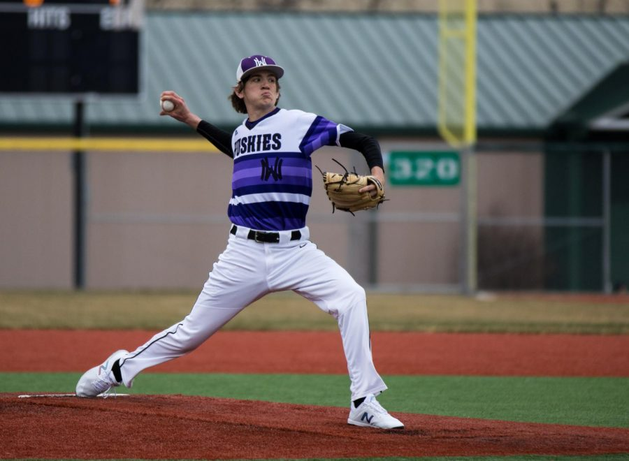 Senior Max Abramovich pitches during the Huskies matchup with Olathe East at the ODAC March 23. The Huskies defeated the Hawks, 3-1.