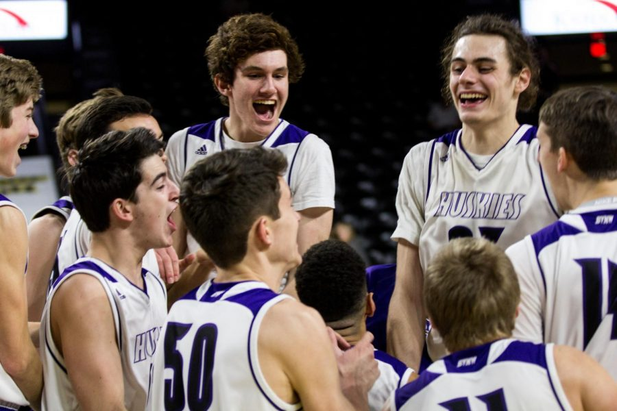 Members of the Blue Valley Northwest team celebrate the win after the Huskies matchup with Lawrence Free State March 10 at Charles Koch Arena. The Huskies defeated the Firebirds, 51-40.