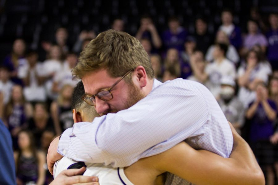 Blue Valley Northwest senior guard Max Johnson (2) embraces assistant coach Zach Harsch after the Huskies matchup with Lawrence Free State March 10 at Charles Koch Arena. The Huskies defeated the Firebirds, 51-40.