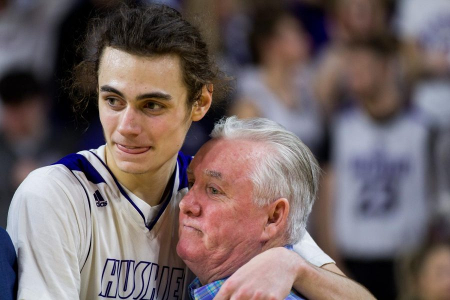 Blue Valley Northwest senior forward Parker Braun hugs head coach Ed Fritz after the Huskies matchup with Lawrence Free State March 10 at Charles Koch Arena. The Huskies defeated the Firebirds, 51-40.