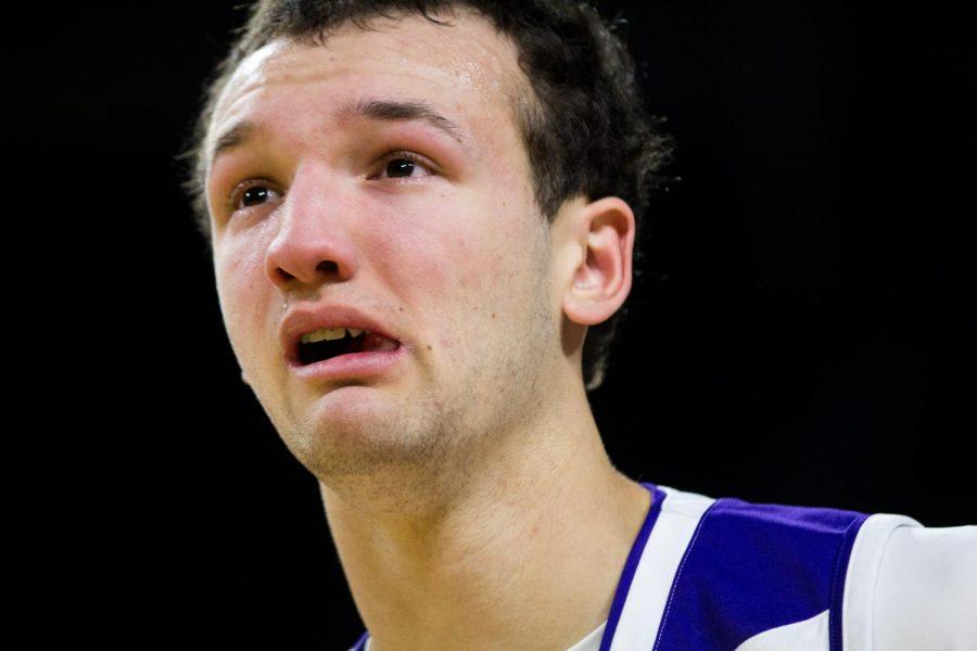 Blue Valley Northwest senior guard Sam Ward cries after the Huskies win.