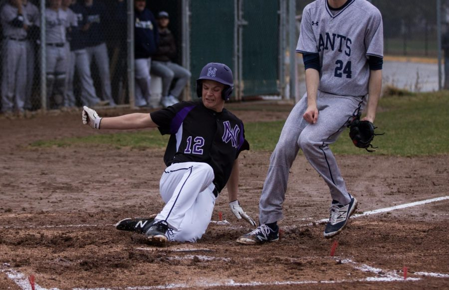Sophomore Ryan Callahan slides into home Wednesday, March 28 in a 9-8 loss to Saint Thomas Aquinas.