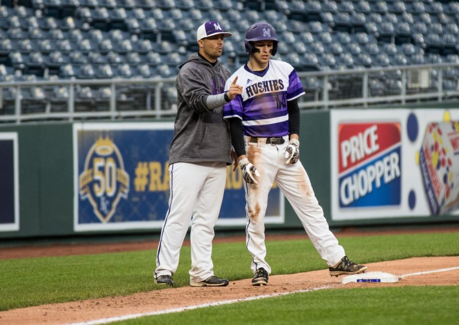 After stealing third base in the bottom of the second inning, junior Ryan Freiermuth listens to instructions from head coach Corby Lange during the Huskies matchup with Summit Christian Academy at Kauffman Stadium April 21.