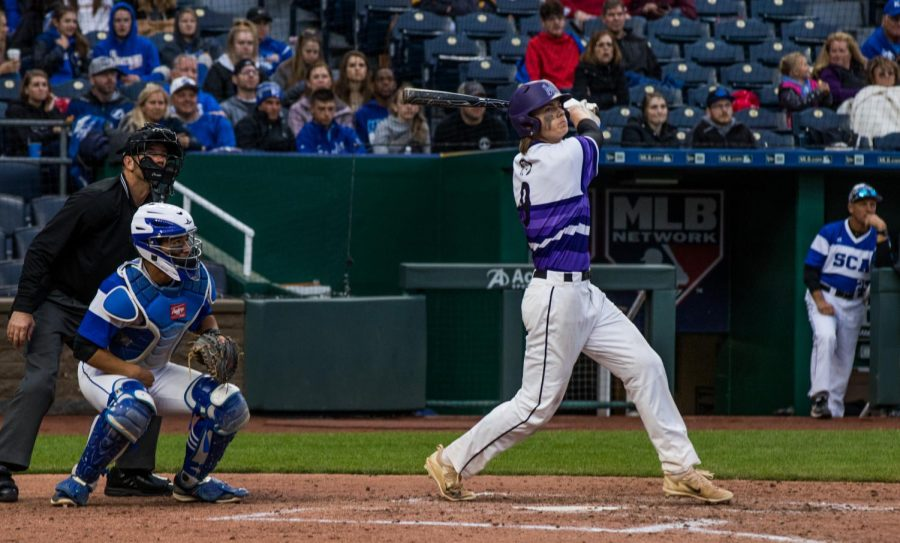 Senior Drew Black follows through after contacting the ball during the Huskies matchup with Summit Christian Academy at Kauffman Stadium April 21. The Huskies defeated the Eagles, 6-2.