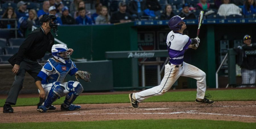 Junior Ryan Freiermuth follows through after hitting the ball during the Huskies matchup with Summit Christian Academy at Kauffman Stadium April 21. The Huskies defeated the Eagles, 6-2.