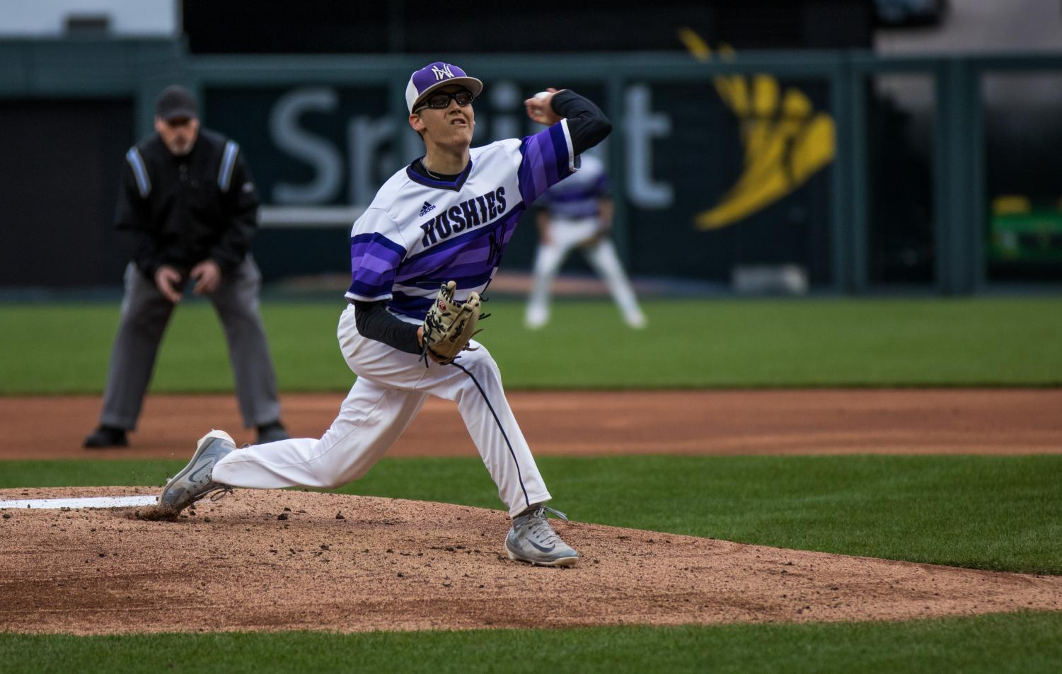 Senior Scott Duensing throws a pitch during the Huskies matchup with Summit Christian Academy at Kauffman Stadium April 21. Duensing threw a complete game and the Huskies defeated the Eagles, 6-2.