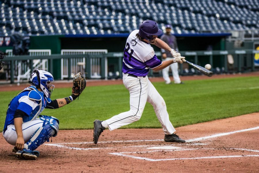 Senior Josh Fiene connects on a double during the bottom of the second inning of the Huskies matchup with Summit Christian Academy at Kauffman Stadium April 21. The Huskies defeated the Eagles, 6-2.